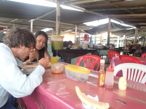 Soaking up the Soup in the Puerto Lopez Market.
